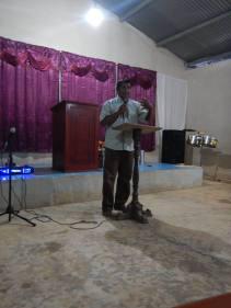 Valerio starting off the church service