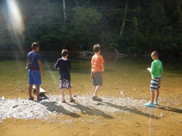 Fernando teaching our boys to fish the Embera way