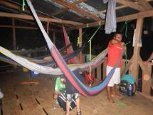 Valerio setting up our hammocks in his house.